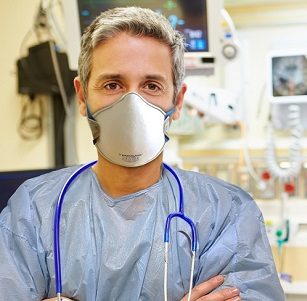 Portrait Of Male Doctor In Emergency Room