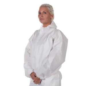 A young woman wearing a white coverall suit with the hood down